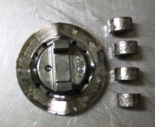 Damaged cam plate and rollers